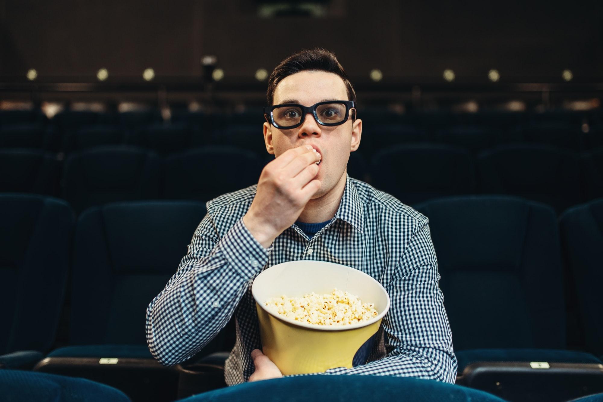 Teenager fascinated watching the film in cinema