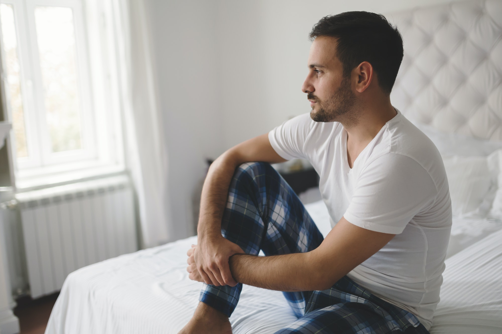 Lonely man in pajamas
